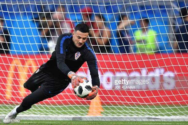 Croatia's goalkeeper Danijel Subasic jumps to catch it as he takes part in a training session of Croatian national football team at the Rostov Arena,...