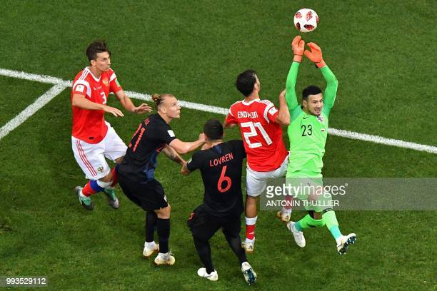 Croatia's goalkeeper Danijel Subasic makes a save during the Russia 2018 World Cup quarterfinal football match between Russia and Croatia at the...