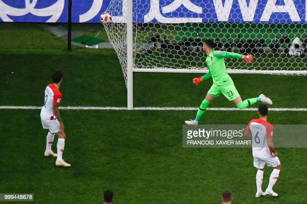 TOPSHOT Croatia's goalkeeper Danijel Subasic reacts after conceding an own goal during their Russia 2018 World Cup final football match between...