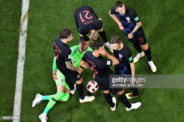 Croatia's goalkeeper Danijel Subasic reacts after getting injured during the Russia 2018 World Cup quarterfinal football match between Russia and...
