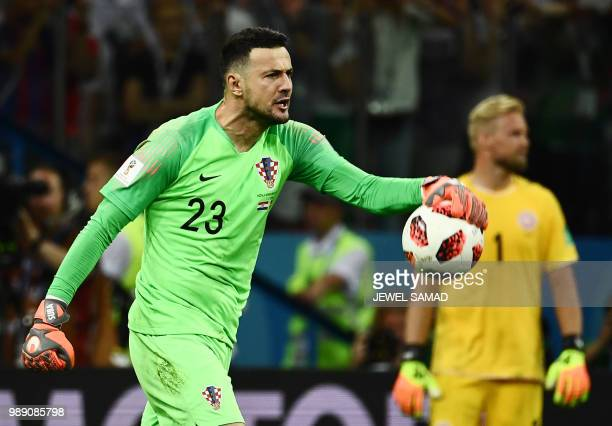 TOPSHOT Croatia's goalkeeper Danijel Subasic reacts after stopping the ball in the penalty shootout during the Russia 2018 World Cup round of 16...