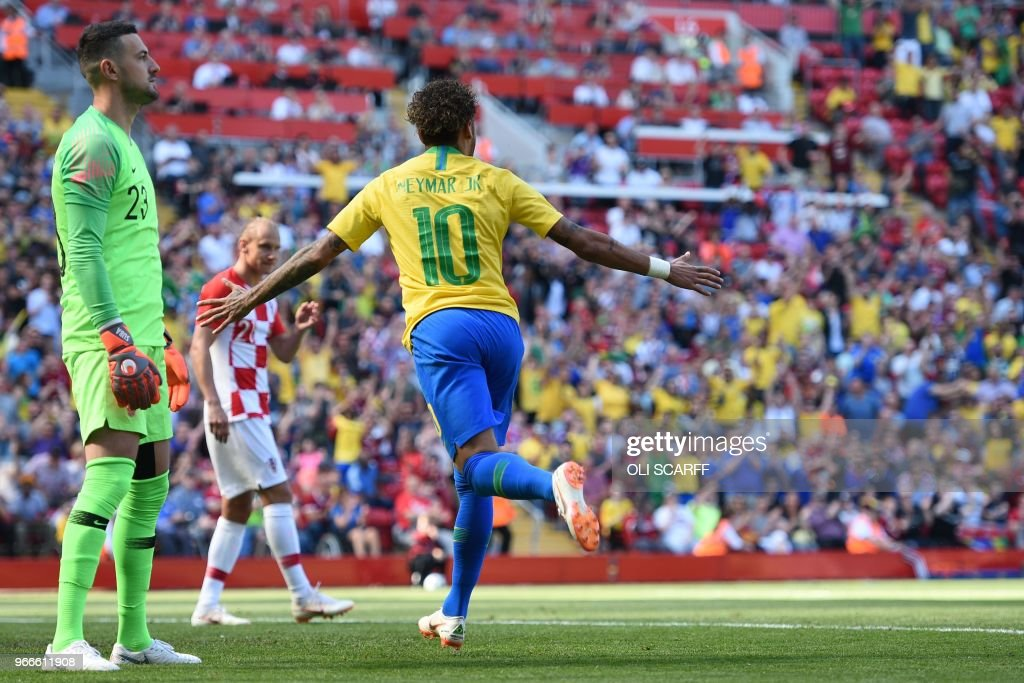 TOPSHOT - Croatia's goalkeeper Danijel Subasic (L) reacts as Brazil's striker Neymar celebrates after scoring the opening goal of the International friendly football match between Brazil and Croatia at Anfield in Liverpool on June 3, 2018.