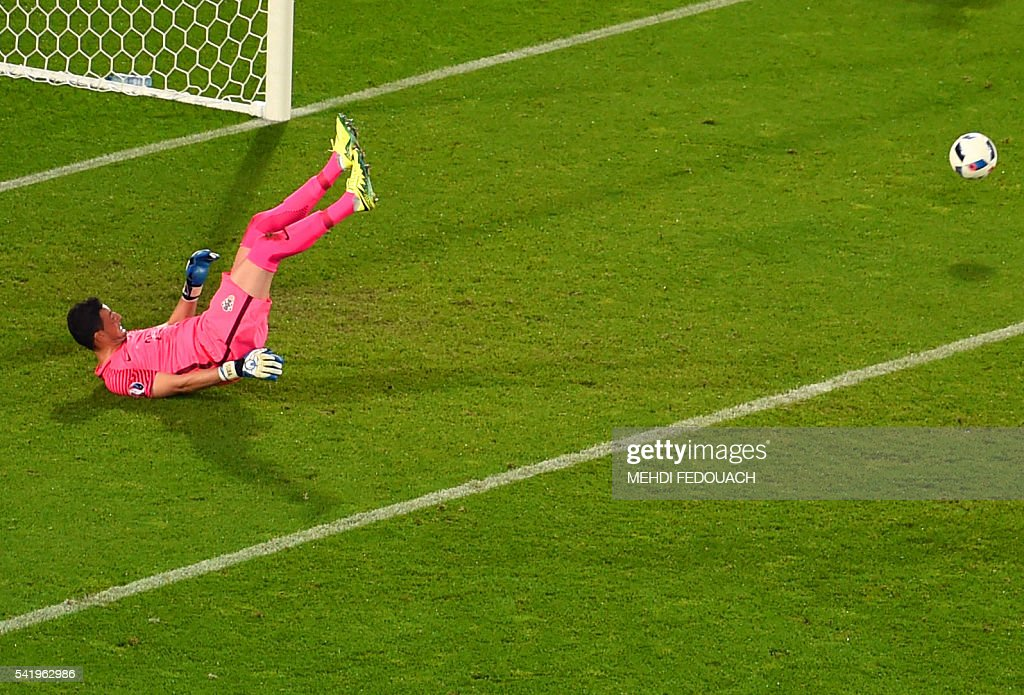 Croatia's goalkeeper Danijel Subasic saves a penalty during the Euro 2016 group D football match between Croatia and Spain at the Matmut Atlantique stadium in Bordeaux on June 21, 2016. / AFP / Mehdi FEDOUACH