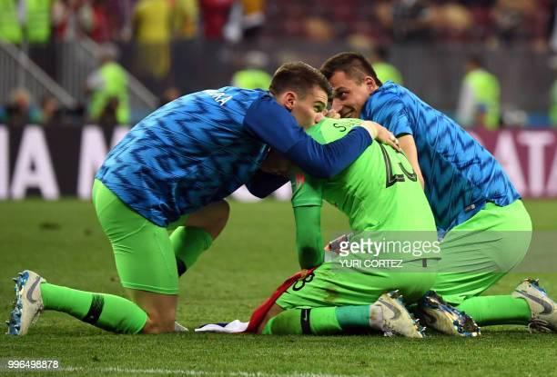 Croatia's goalkeeper Dominik Livakovic Croatia's goalkeeper Danijel Subasic and Croatia's goalkeeper Lovre Kalinic celebrate at the end of the Russia...