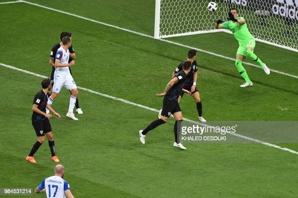 Croatia's goalkeeper Lovre Kalinic blocks a shot on goal during the Russia 2018 World Cup Group D football match between Iceland and Croatia at the...