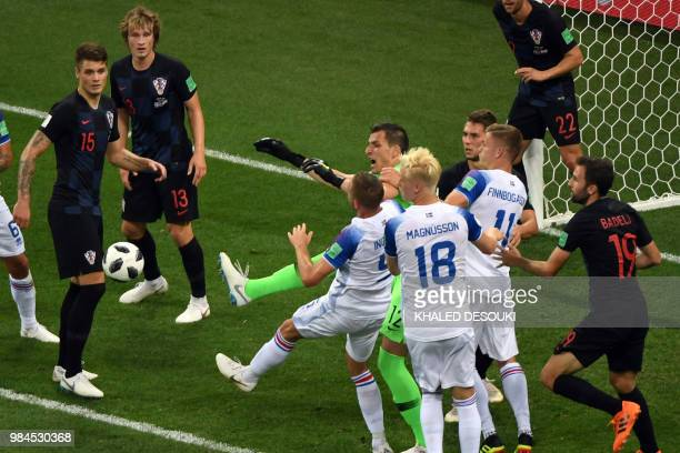 Croatia's goalkeeper Lovre Kalinic reacts as he tries to block a shot on goal by Iceland during the Russia 2018 World Cup Group D football match...