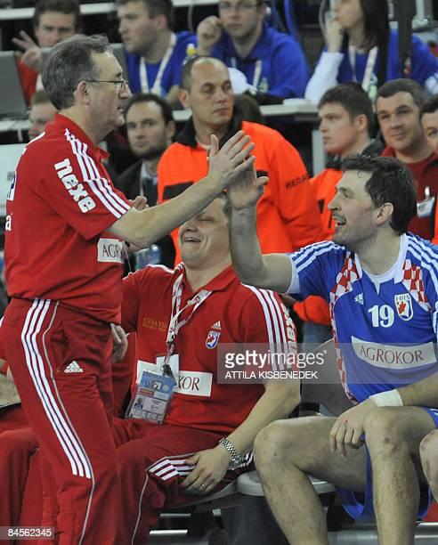 Croatia's head coach Lino Cervar celebrates with Croatia's Petar Metlicic after defeating Poland at the end of their men's World Championships...