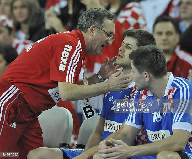 Croatia's head coach Lino Cervar gives instructions to Croatia's Tonci Valcic during their men's World Championships semifinals match against Poland...
