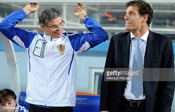 Croatia's head coach Slaven Bilic and his deputy and former coplayer Aljosa Asanovic look on before the Euro 2012 group F qualifying match between...
