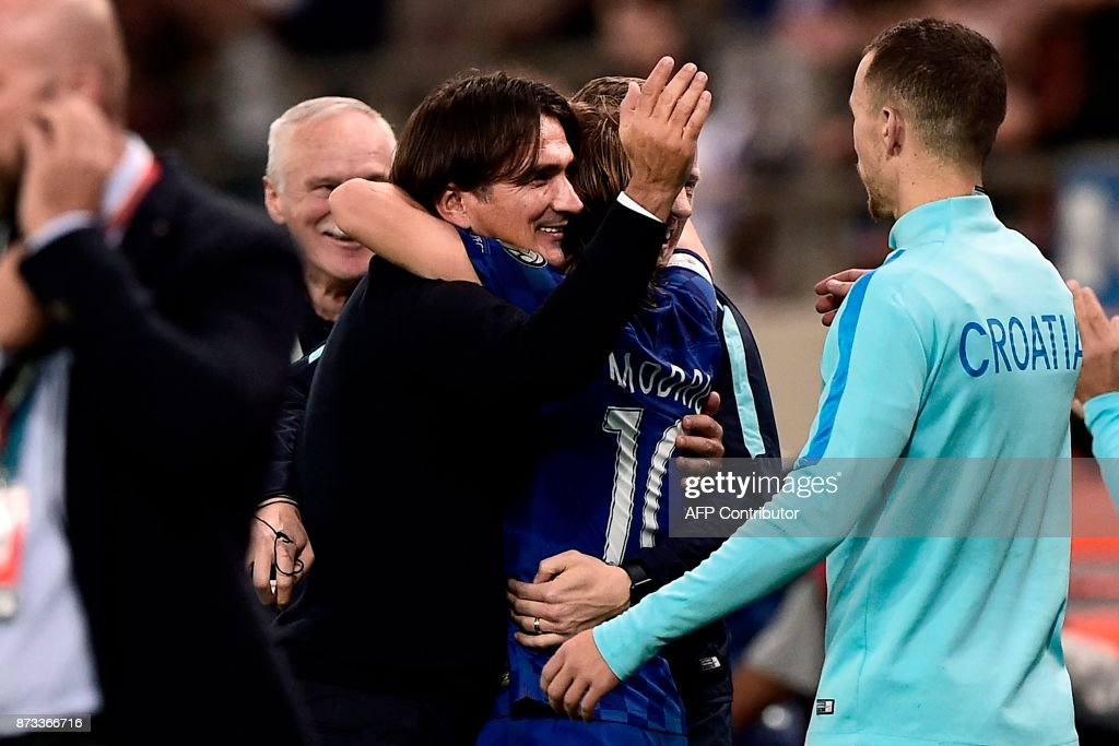 Croatia's head coach Zlatko Dalic celebrates with his team after winning the World Cup 2018 play-off football match between Greece and Croatia, on November 12, 2017 at the Georgios Karaiskakis Stadium in Piraeus. Croatia qualified for the 2018 World Cup by holding Greece to a 0-0 draw in the second leg of their play-off in Piraeus for a 4-1 win on aggregate. /