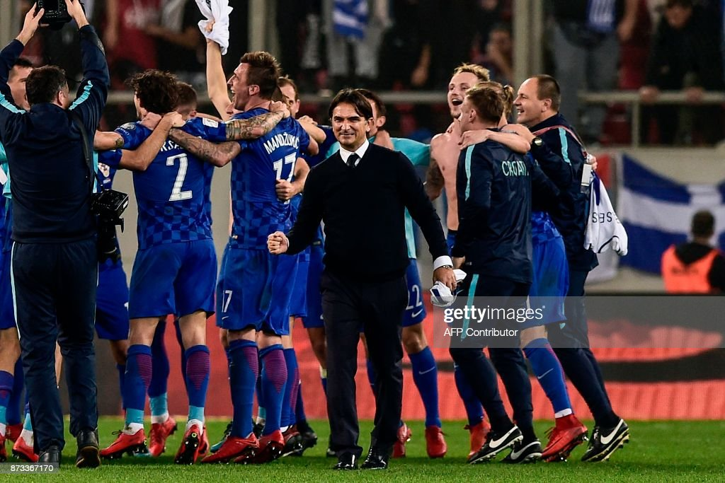 Croatia's head coach Zlatko Dalic (C) celebrates with his team after winning the World Cup 2018 play-off football match between Greece and Croatia, on November 12, 2017 at the Georgios Karaiskakis Stadium in Piraeus. Croatia qualified for the 2018 World Cup by holding Greece to a 0-0 draw in the second leg of their play-off in Piraeus for a 4-1 win on aggregate. /