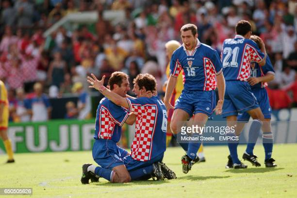 Croatia's Igor Stimac and Slaven Bilic celebrate victory over Romania