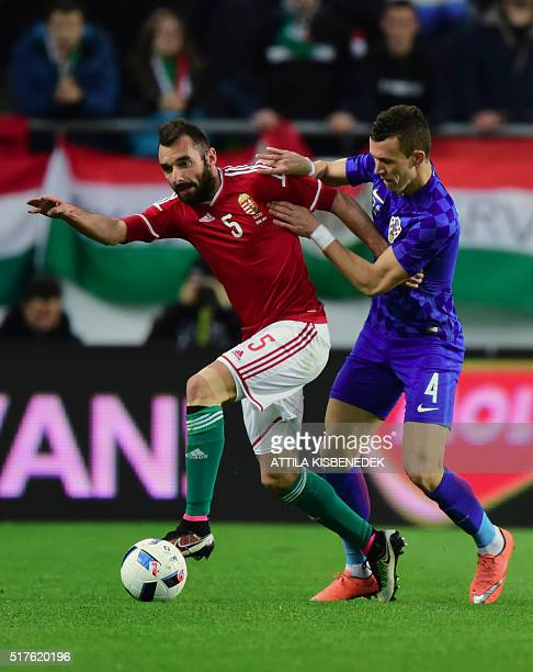Croatia's Ivan Perii vies with Hungary's Attila Fiola during the friendly football match Hungary v Croatia at the Ferenc Puskas Stadion in Budapest...