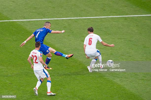 Croatia's Ivan Perisic scores the opening goal despite the attentions of Czech Republic's Tomas Sivok during the UEFA Euro 2016 Group D match between...