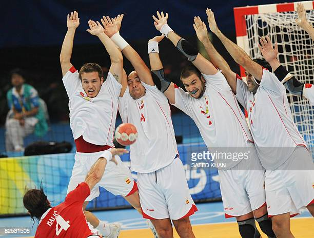 Croatia's Ivano Balic tries to score as players of Spain defend during the men's handball bronze medal match of the 2008 Beijing Olympic Games on...