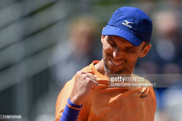 TOPSHOT Croatia's Ivo Karlovic reacts during his men's singles first round match against Spain's Feliciano Lopez on day three of The Roland Garros...