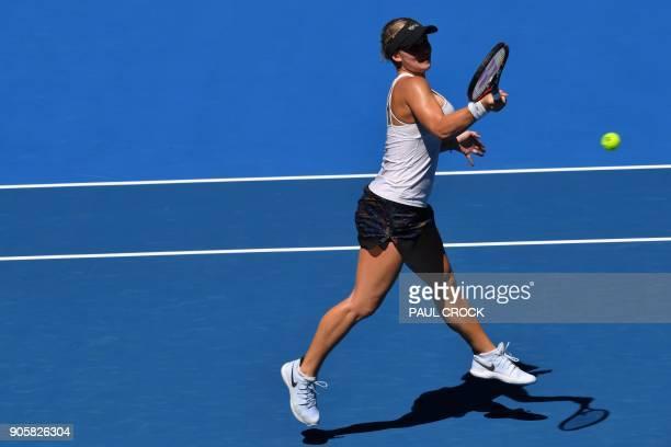Croatia's Jana Fett hits a return against Denmark's Caroline Wozniacki during their women's singles second round match on day three of the Australian...