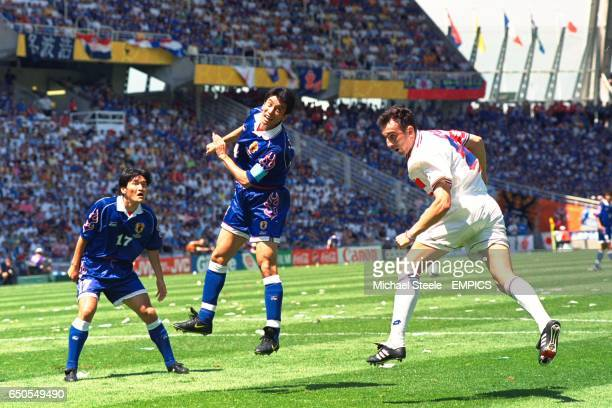 Croatia's Krunoslav Jurcic heads for goal