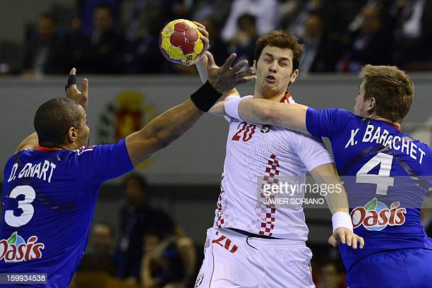 Croatia's left back Damir Bicanic vies with France's right back Xavier Barachet and France's pivot Didier Dinart during the 23rd Men's Handball World...