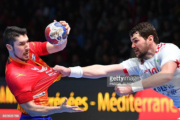 TOPSHOT Croatia's left back Jakov Gojun defends against Spain's right back Alex Dujshebaev during the 25th IHF Men's World Championship 2017 quarter...