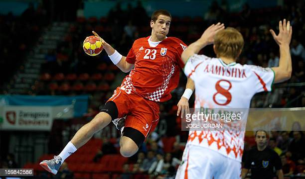 Croatia's left back Stipe Mandalinic vies with Belarus' left back Dzmiytry Kamyshyk during the 23rd Men's Handball World Championships round of 16...