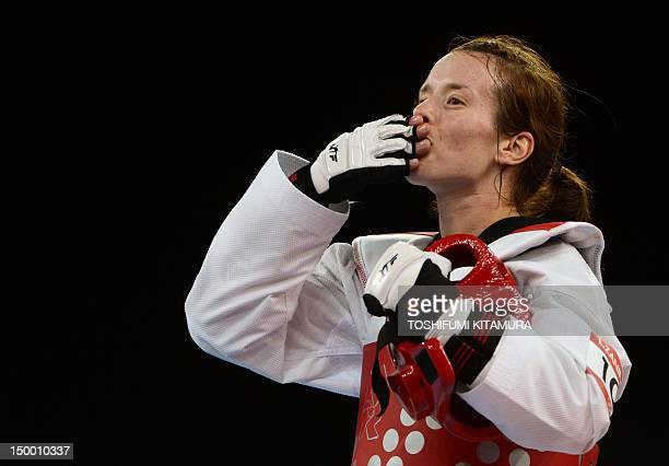 Croatia's Lucija Zaninovic celebrates her victory over Mexico's Jannet Alegria Pena at the end of her women's taekwondo bronze medal bout in the...
