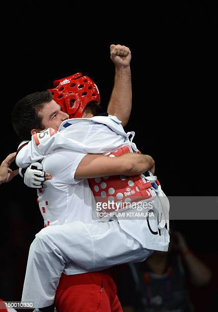 Croatia's Lucija Zaninovic celebrates with her coach her victory over Mexico's Jannet Alegria Pena at the end of her women's taekwondo bronze medal...