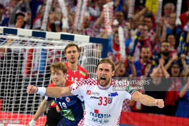 Croatia's Luka Cindric reacts after scoring a goal during their group I match of the Men's 2018 EHF European Handball Championship between Croatia...
