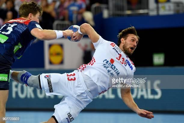 Croatia's Luka Cindric shoots the ball past Norway's Goran Johannessen during the group I match of the Men's 2018 EHF European Handball Championship...