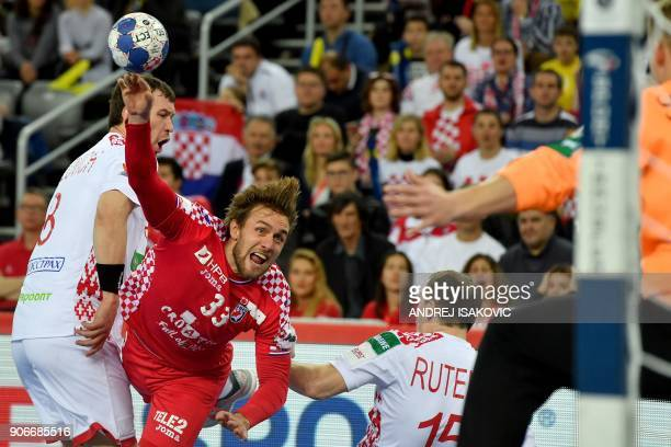 Croatia's Luka Cindric vies with Belarus' Siarhei Shylovich and Dzianis Rutenka during the group I match of the Men's 2018 EHF European Handball...