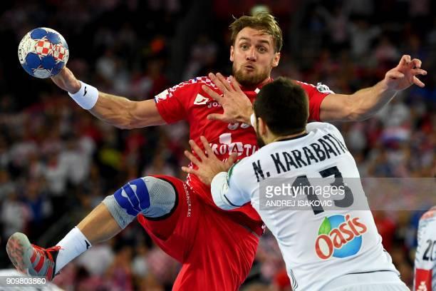 Croatia's Luka Cindric vies with France's Nikola Karabatic during the group I match of the Men's 2018 EHF European Handball Championship between...