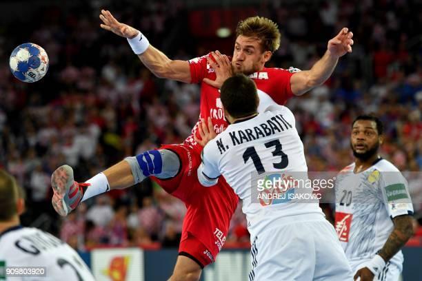 TOPSHOT Croatia's Luka Cindric vies with France's Nikola Karabatic during the group I match of the Men's 2018 EHF European Handball Championship...