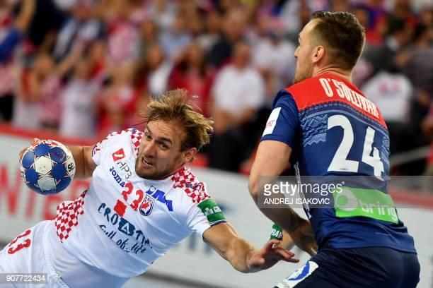 Croatia's Luka Cindric vies with Norway's Christian O'Sullivan during the group I match of the Men's 2018 EHF European Handball Championship between...