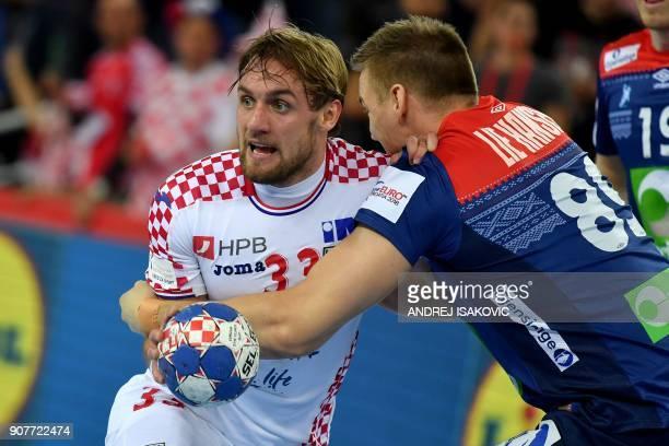 Croatia's Luka Cindric vies with Norway's Espen Lie Hansen during the group I match of the Men's 2018 EHF European Handball Championship between...