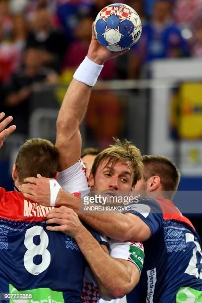 Croatia's Luka Cindric vies with Norway's Goran Johannessen and Bjarte Myrhol during the group I match of the Men's 2018 EHF European Handball...