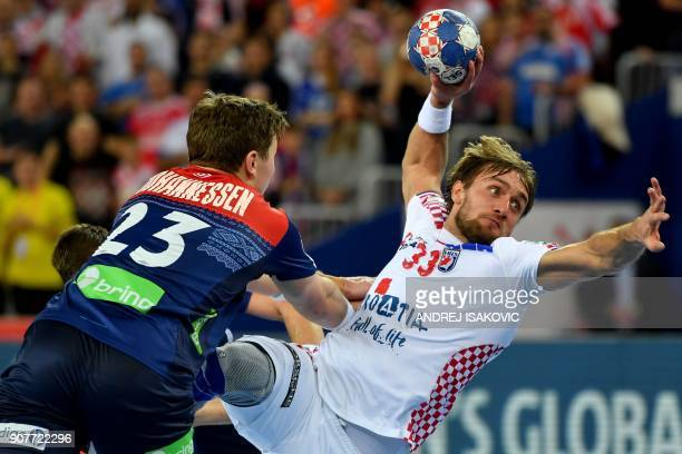 Croatia's Luka Cindric vies with Norway's Goran Johannessen during their group I match of the Men's 2018 EHF European Handball Championship between...