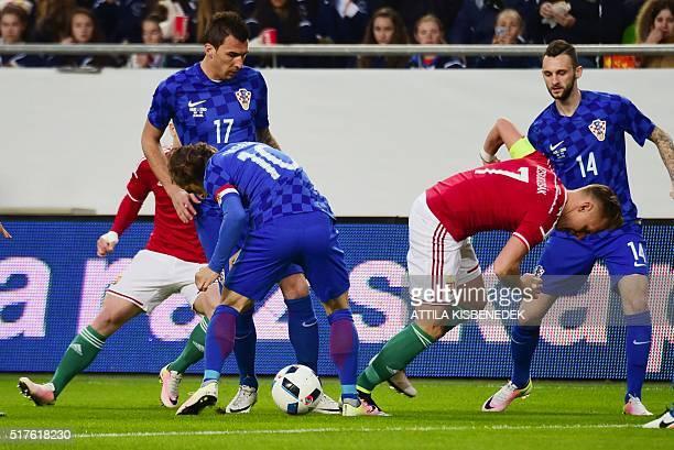 Croatia's Luka Modric vies with Hungary's Balazs Dzsuzsak during the friendly football match Hungary v Croatia at the Ferenc Puskas Stadion in...