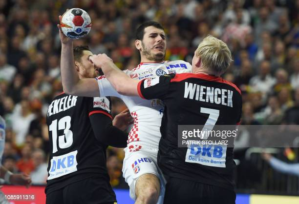 TOPSHOT Croatia's Luka Stepancic Germany's Patrick Wiencek and Germany's Hendrik Pekeler vie for the ball during the IHF Men's World Championship...