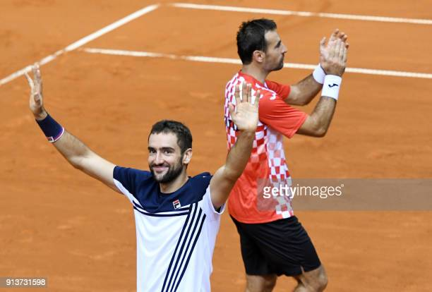 Croatia's Marin Cilic and Ivan Dodig celebrate after winning the double match as part of the Davis Cup World Group tennis match between Croatia and...