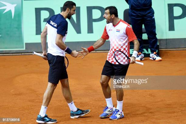 Croatia's Marin Cilic and Ivan Dodig celebrate as they play against Canada's Daniel Nestor and Vasek Pospis during the Davis Cup World Group fiorst...