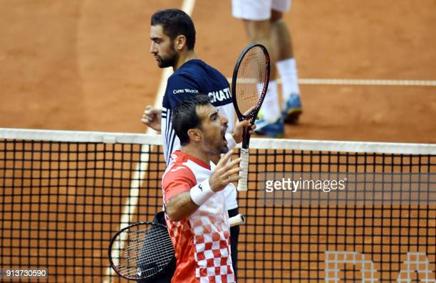 Croatia's Marin Cilic and Ivan Dodig celebrates after winning a point during the double match as part of the Davis Cup World Group tennis match...