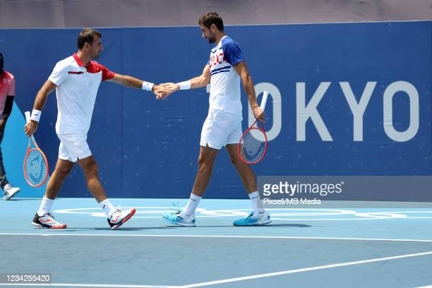 Croatia's Marin Cilic and Ivan Dodig during the Men's Doubles quaterfinal match against Andy Murray and Joe Salisbur of Great Britain on day five of...