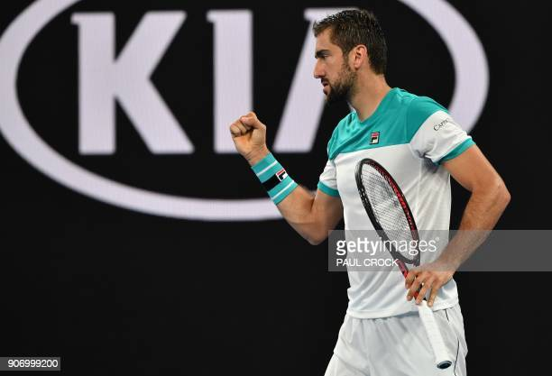 Croatia's Marin Cilic celebrates after a point against Ryan Harrison of the US during their men's singles third round match on day five of the...