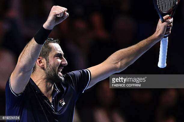 Croatia's Marin Cilic celebrates after beating Japan's Kei Nishikori in the Swiss Indoors ATP 500 tennis tournament final match in Basel on October...