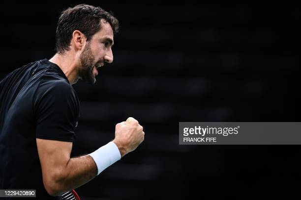Croatia's Marin Cilic celebrates after winning a point against Canada's Felix Auger-Aliassime during their men's singles first round tennis match on...