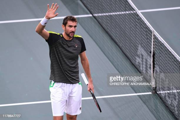 Croatia's Marin Cilic celebrates after winning against Poland's Hubert Hurkacz after their men's singles tennis match on day one of the ATP World...