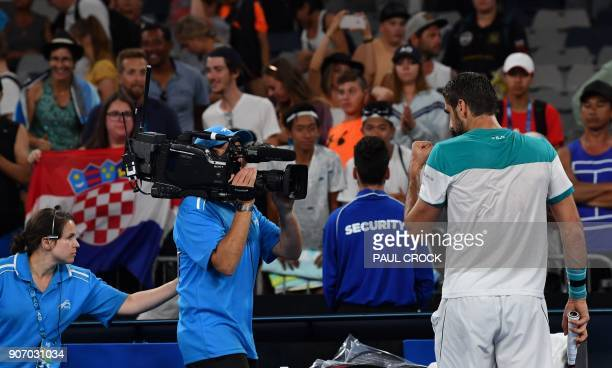 Croatia's Marin Cilic celebrates beating Ryan Harrison of the US in their men's singles third round match on day five of the Australian Open tennis...
