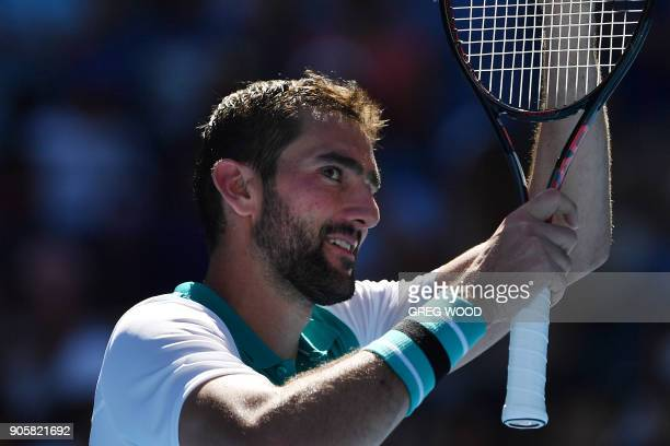 Croatia's Marin Cilic celebrates his victory against Portugal's Joao Sousa during their men's singles second round match on day three of the...