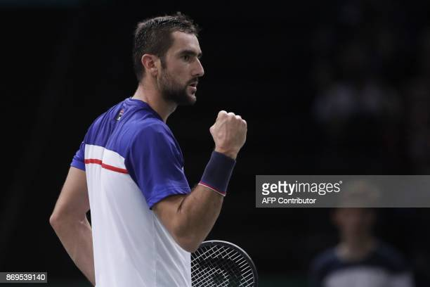 Croatia's Marin Cilic celebrates winning a point against Spain's Roberto Bautista Agut during the 1/8 round at the ATP World Tour Masters 1000 indoor...