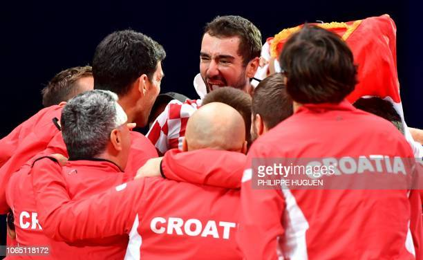Croatia's Marin Cilic celebrates with teammates after victory over France's Lucas Pouille in their singles rubber for the Davis Cup final tennis...